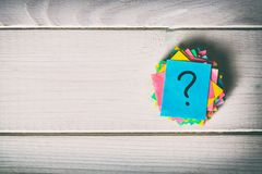 Just a lot of question marks on colored papers. vintage background stock photo