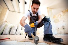 Just making place for new parquet. With hammer, crowbar and hard work royalty free stock photos