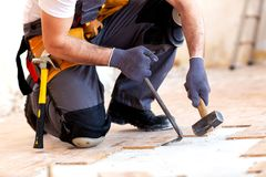 Just making place for new parquet. With hammer, crowbar and hard work stock photos