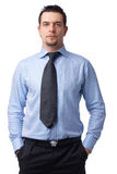 Just Man. Portrait of a confident businessman standing with his hands in the pockets on white Stock Photography