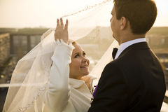 Just married. Newlywed couple over sunny sky Stock Photo