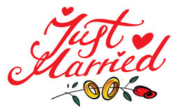 Just Married. Inscription, golden rings and red rose flower Stock Photo