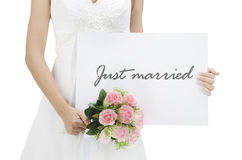 Just married. Bride holding a just married card stock image