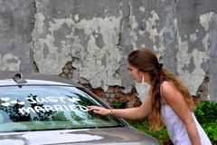 Just married. Woman find the Just Married sign on the back of their car royalty free stock photo