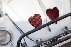 Just married. Retro car with heart symbol stock photos