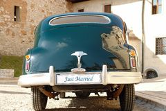 Just married. Rear of dark green retro wedding car with just married license plate royalty free stock photo