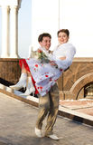 Just married. Couple running on the back of church Stock Photo
