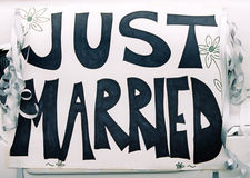 Just married. A hand lettered just married sign decorates a newlywed couple's car Stock Photography