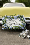 Just Married. Bumper of limousine with just married sign and cans attached royalty free stock photos