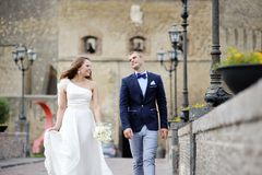 Just married bride and groom smiling in wedding day Stock Image