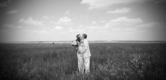Just married couple. On the field. black-and-white photo Royalty Free Stock Images