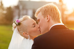 Just married couple. Just married happy couple kissing outdoors stock images