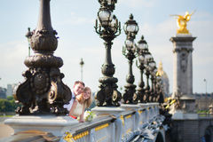 Just married couple on the Alexandre III bridge Stock Photos
