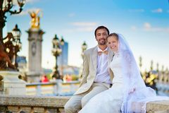Just married couple on the Alexandre III bridge Royalty Free Stock Photos