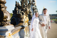 Just married couple on the Alexandre III bridge Royalty Free Stock Images