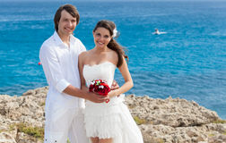 A just married couple on the beach. A just married  beautiful couple on the sea beach Stock Photos