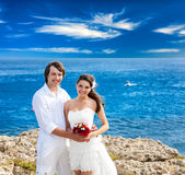 A just married couple on the beach. A just married  beautiful couple on the sea beach Royalty Free Stock Photography