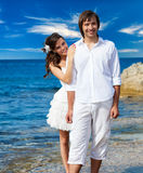 A just married couple on the beach. A just married beautiful couple on the sea beach Royalty Free Stock Image