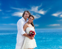 A just married couple on the beach Stock Photos
