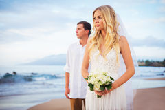 Just married couple on beach at sunset. Just married couple on the beach, Hawaii Beach Wedding Royalty Free Stock Image