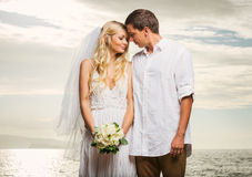 Just married couple on beach at sunset Stock Photography