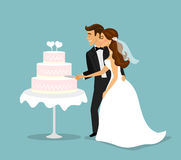 Just married couple cutting wedding cake Stock Image
