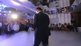 Just married couple is dancing at wedding party stock footage