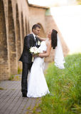 Just married couple dancing in yard of ancient castle Royalty Free Stock Image