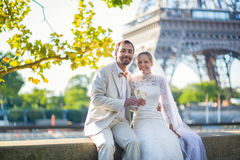 Just married couple drinking champagne. Beautiful just married couple drinking champagne near the Eiffel tower Stock Images