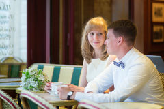 Just married couple drinking coffee in a cafe Stock Photos