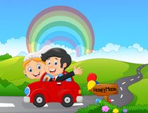 Just married couple driving a car in honeymoon trip Stock Photos