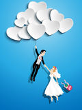 Just married couple flying with a heart balloon Stock Photo