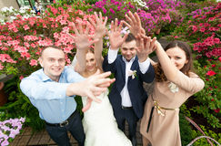 Just married couple with friends holding hands up Royalty Free Stock Images