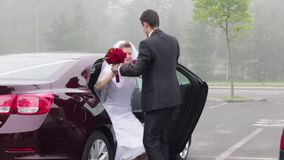 Just married couple getting out of car stock video footage