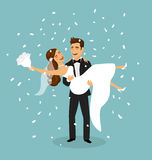 Just married couple, groom carries bride in arms after wedding ceremony Royalty Free Stock Image
