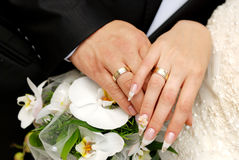 Just married couple hands. On a bouquet Stock Photo