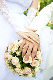 Just married couple hands. With flowers Royalty Free Stock Image