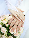 Just married couple hands. On a flowers Stock Image