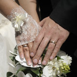 Just married couple hands. With flowers Royalty Free Stock Photography
