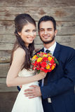 Just married couple happy smiling on wodden background Royalty Free Stock Photography