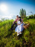 Just married couple having picnic at meadow Royalty Free Stock Photography