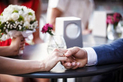 Just married couple hold each other's hands. Stock Images