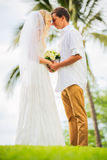 Just married couple holding hands. Intimate loving moment at wedding Stock Image