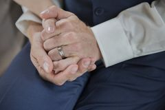 Just married couple holding hands. Close up Stock Photography