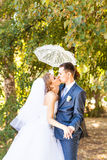 Just married couple holding white umbrella Royalty Free Stock Images