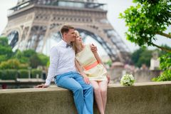 Just married couple hugging near the Eiffel tower Stock Images