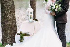Just married couple hugs outdoor with bouquet Royalty Free Stock Photography