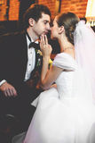 Just married couple leans to each other with their faces tenderl Stock Images
