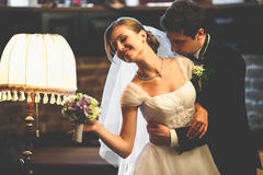 Just married couple leans to each other with their faces tenderl Royalty Free Stock Image