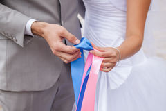 Just Married. Couple in love holding a ribbon of pink and blue to mark sex of birth Stock Images